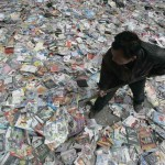 A worker prepares to destroy pirated CDs and DVDs during a campaign against piracy in Taiyuan