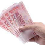 Chinese yuan in male hand