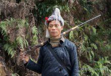 Photo of Basha Miao (岜沙苗寨) – jedyni ludzie w Chinach, którym wolno posiadać i używać broni palnej.